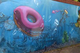 """Weiße Rose"" Graffiti mit Donut in Karlsruhe"
