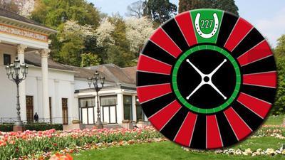 Roulette und Hufeisen: Das Logo des Round Table 227 Baden-Baden, hier vor der Kulisse des Kurhauses, bezieht sich bewusst aufs Baden-Badener Casino und die Galopprennbahn in Iffezheim.