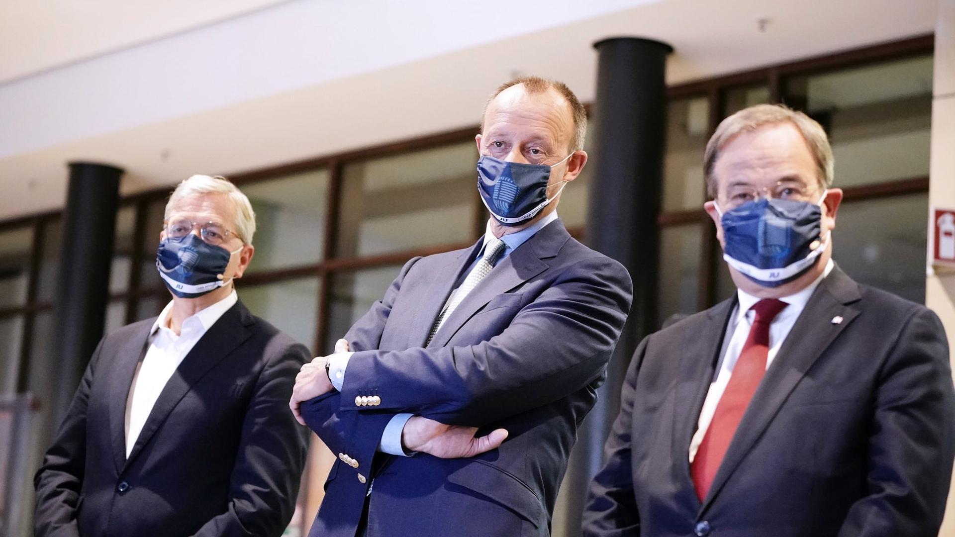 Die drei Kandidaten für den Bundesvorsitz der CDU: Armin Laschet, (r-l) Friedrich Merz und Norbert Röttgen.