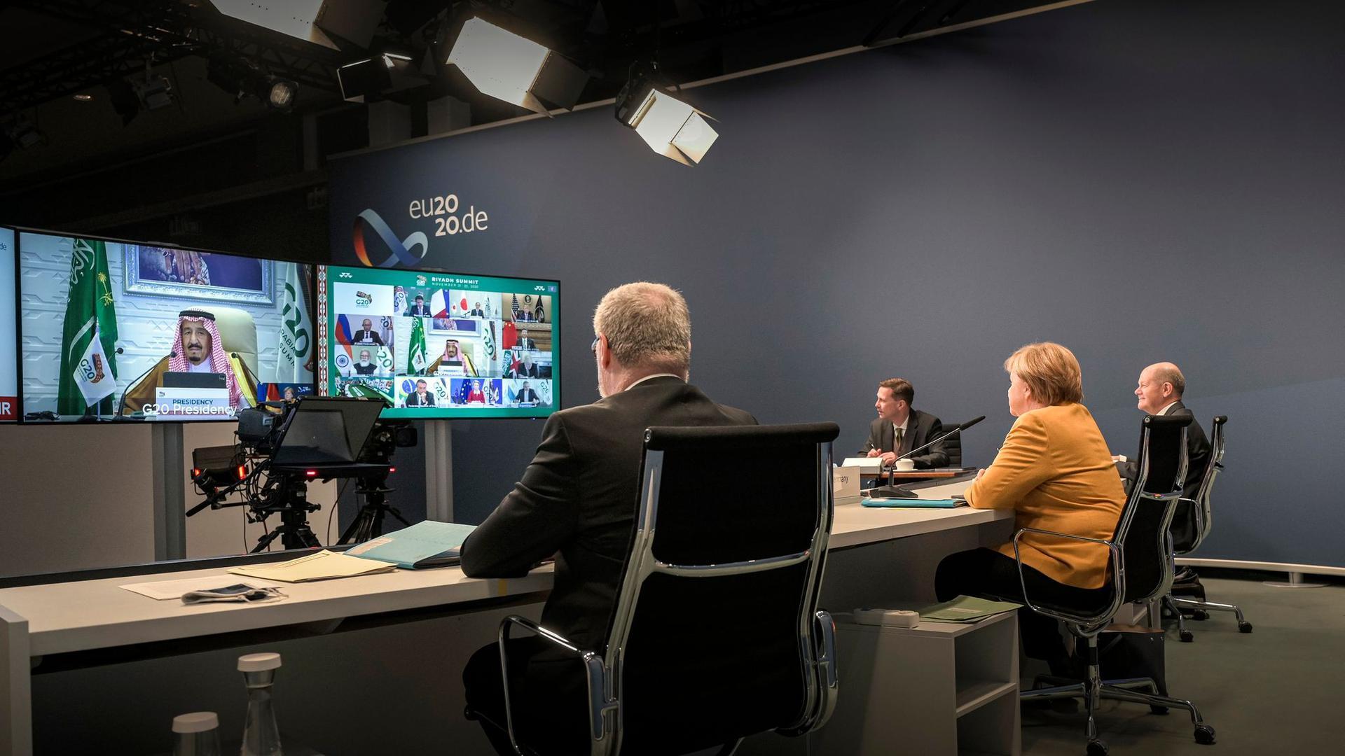 Kanzlerin Merkel und Finanzminister Olaf Scholz nehmen am virtuellen G20-Gipfel teil.