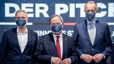 Die drei Kandidaten für den Bundesvorsitz der CDU, Armin Laschet in der Mitte, Friedrich Merz rechts im Bild und Norbert Röttgen, links.