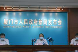 Auf einer Pressekonferenz der örtlichen Behörden in Xiamen werden die neuen Maßnahmen vorgestellt.