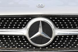 A Mercedes-Benz star is pictured is seen on the front of an passenger car in Stuttgart, southern Germany, on February 18, 2021 as Daimler holds the annual press conference as an online event.  Mercedes-Benz parent company Daimler on February 18, 2021 released preliminary earnings data for 2020 showing higher-than-expected operating profit in a year battered by the coronavirus pandemic. / AFP / THOMAS KIENZLE