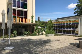 """A.K.T. (Alfons-Kern-Turm), Café Roland, zerstörte Plakate zur Ausstellung """"Das dritte Geschlecht"""""""