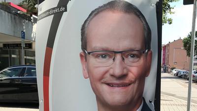 Ein CDU-Wahlplakat in Pforzheim zeigt das Gesicht von Gunther Krichbaum.