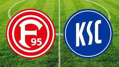 Fortuna Düsseldorf Logo und KSC Logo vor dem Fußballplatz