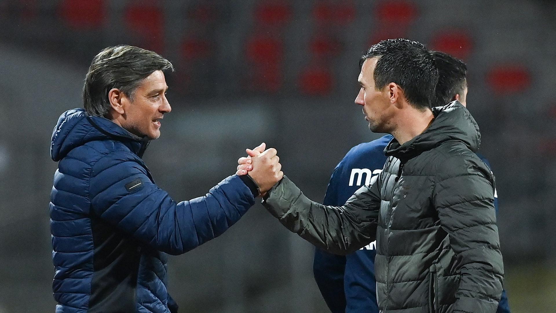 Einträchtig nach Spielende: Trainer Christian Eichner und Sportdirektor Oliver Kreuzer nach Schlusspfiff in Nürnberg.