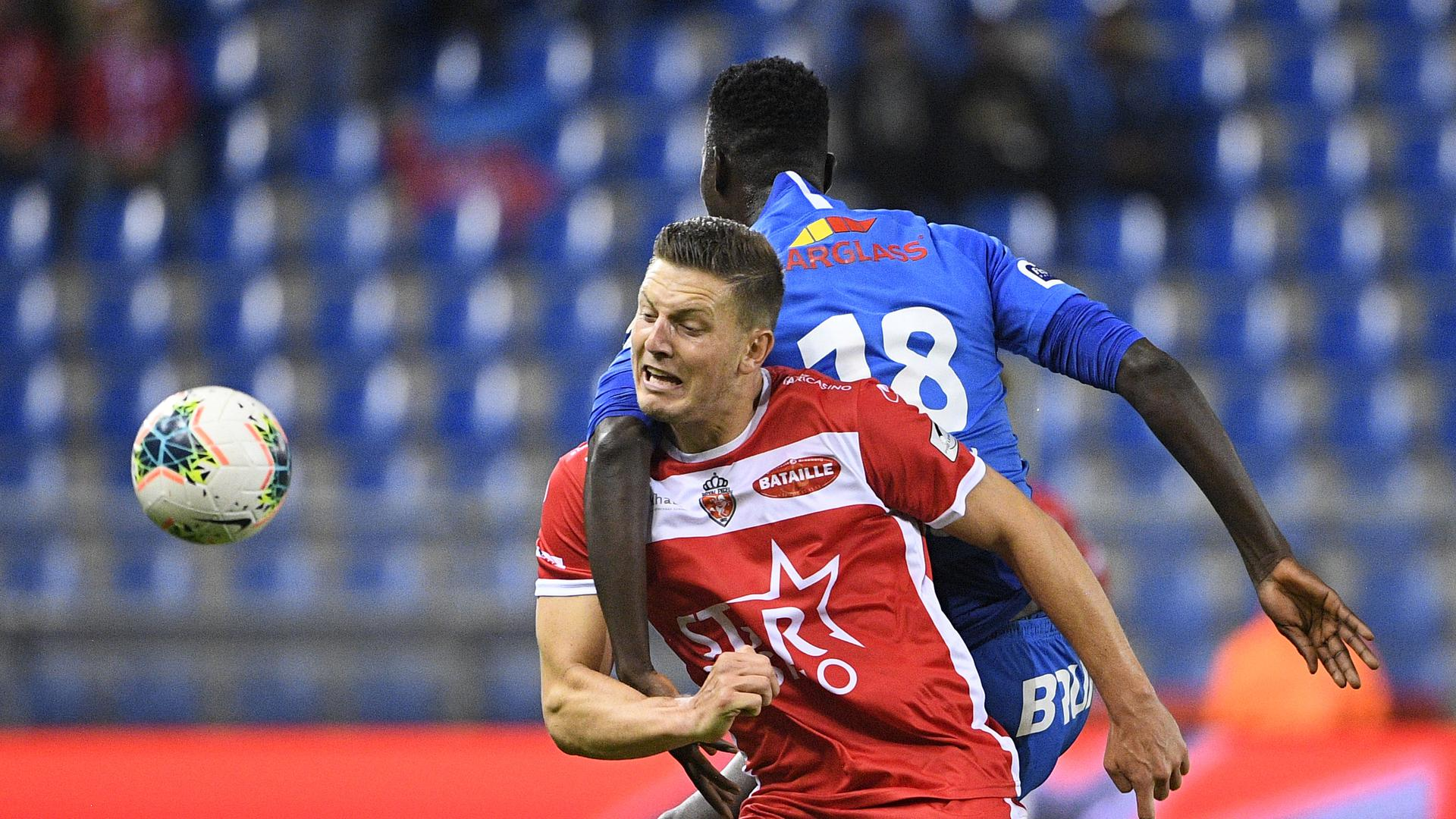 Mouscron s Kevin Wimmer and Genk s Paul Onuachu fight for the ball during a soccer match between RC Genk and Royal Excel Mouscron, Sunday 06 October 2019 in Genk, on day ten of the Jupiler Pro League Belgian soccer championship season 2019-2020. YORICKxJANSENS PUBLICATIONxINxGERxSUIxAUTxONLY x05681325x