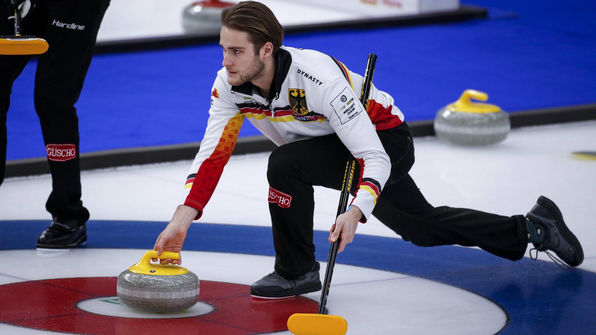 April 3, 2021, Calgary, ab, Canada: Germany skip Sixten Totzek makes a shot as he plays Switzerland at the Men s World Curling Championships in Calgary, Alta., Saturday, April 3, 2021. Sixten Totzek PUBLICATIONxINxGERxSUIxAUTxONLY - ZUMAc35_ 20210403_zaf_c35_009 Copyright: xJeffxMcintoshx
