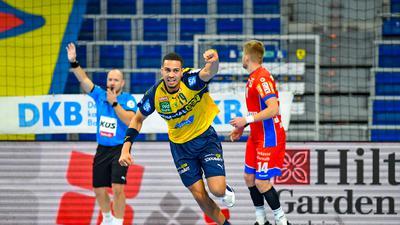 Philipp Ahouansou #19 / RNL       , Rhein-Neckar Loewen vs.  HBW Balingen-Weilstetten, RNL Saison 2020 / 2021,  © Copyright: AS Sportfoto / Soerli Binder,  www. as-sportfoto.de, MSP_0111_RNL_